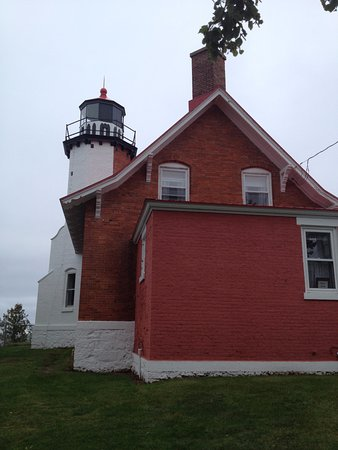 Eagle Harbor, MI: The front half of the lighthouse (closest to the water) is white and the back is unpainted.