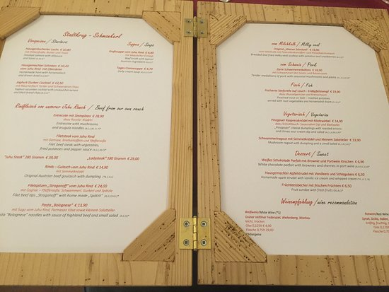 The menu is wrapped in a wood frame. - Picture of Stadtkrug ...