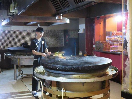 Altai Barbecue Restaurant: The chef in the kitchen.