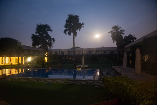Trident, Agra: Inner Place with Pool at night