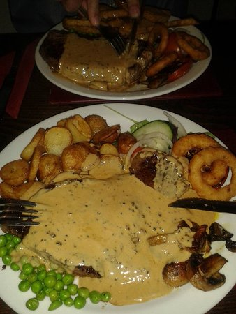 The Queen Inn: steak with peppercorn sauce, saute potatoes and all the trimmings.