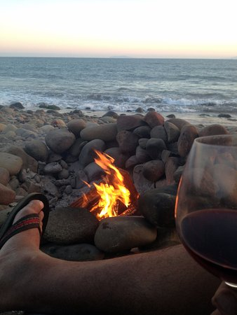 A nice glass of wine by the fire at sunset Picture of Emma Wood