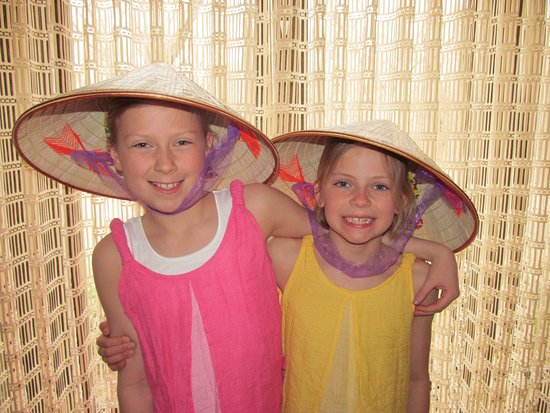 Viet Vision Travel - Day Tours: Kids happy with colonial Hats from Vietnam