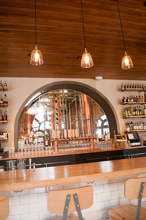 back bar lighting. The Depot Craft Brewery Distillery: Back Bar Showcasing Copper Still Lighting