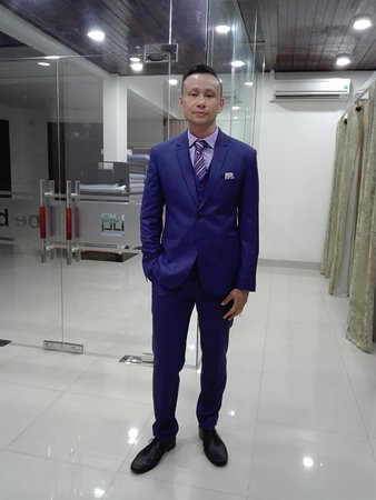 Navy suit with purple dress shirt and striped tie ...
