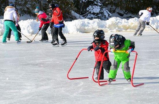 Buckhorn, Canada: Kids skating on the lake - Christine Brickman