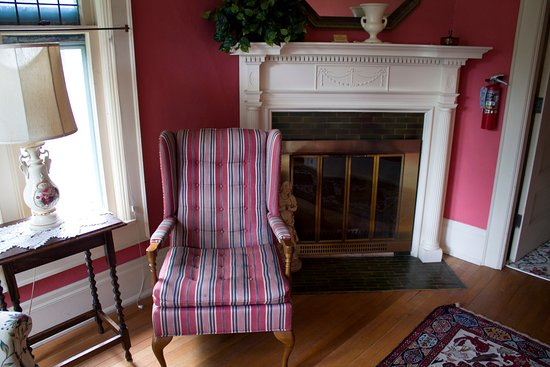 Alma, MI: Ammi Wright sitting room with woodburning fireplace