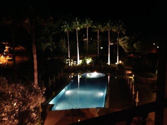 Hotel Cala Sant Vicenc: Pool at night from balcony.