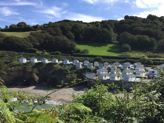 View from coastal oath looking down into Hele Cove with the beach huts