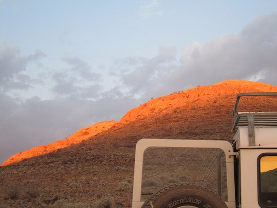 Barchan Dune Retreat: Sunset colours on the mountain.