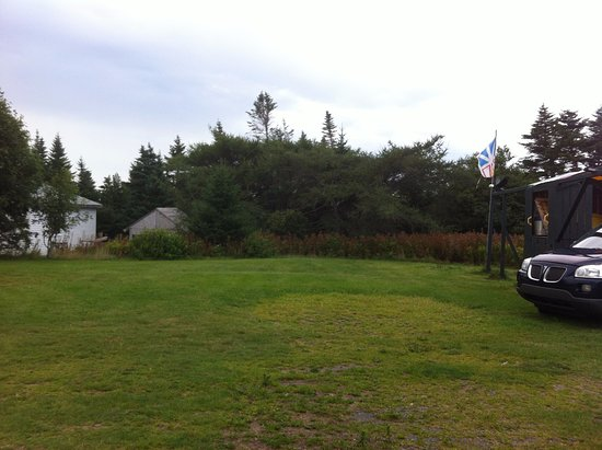 Witless Bay, Canada: grassy lawn view from side patio of #1