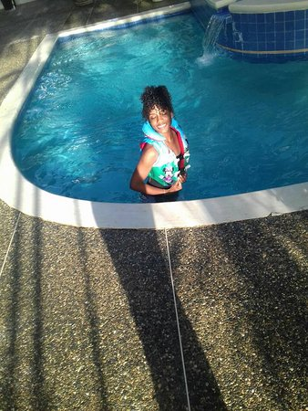 Sea Shells Vacation Villas: my daughter enjoying the pool with her little brothers life vest.... lolol