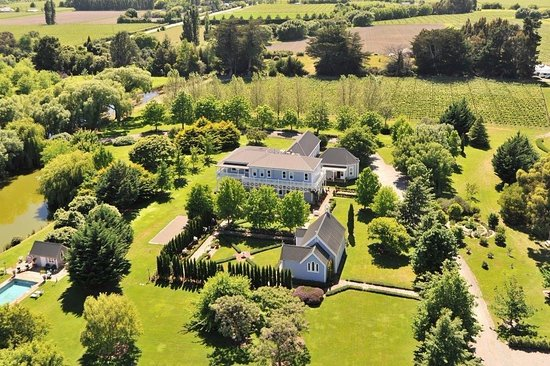 The Marlborough Lodge: Aerial view from the west showing pool, chapel and lodge at the back
