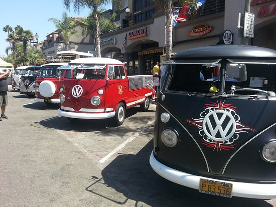 Downtown Huntington Beach: Classic Volkswagon Vans line up on Main Street during Surf City Days