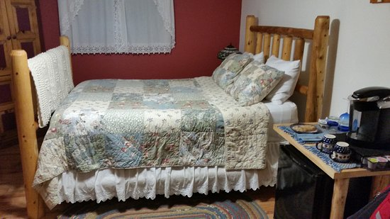 Thornton, NH: The master bedroom with cookies on table with Kuerig
