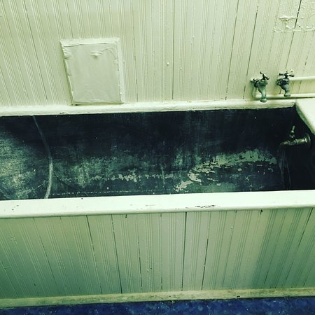 Freeport, IL: A copper tub in the bathroom of a former apartment.