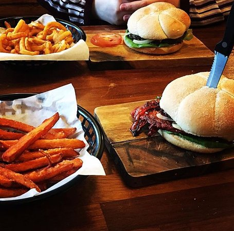 Denton, UK: Bombay burger with sweet potato fries and Gourmet cheeseburger and curly fries