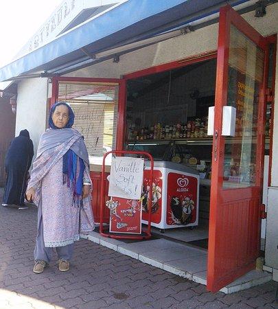 Slubice, Polen: My wife Sabiha standing outside a grocery shop.