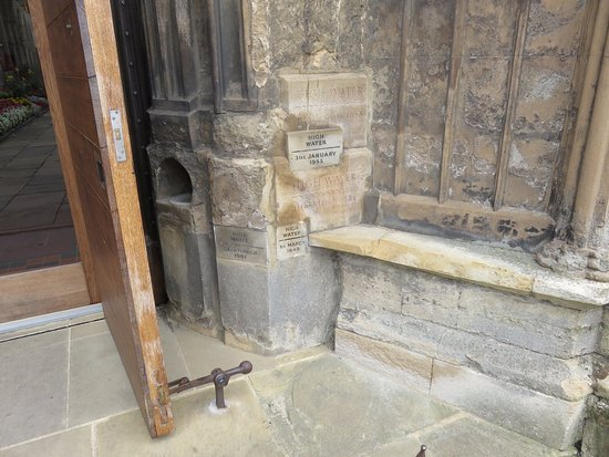 Kings Lynn Minster: Entrance to Minster marks flood levels for various years