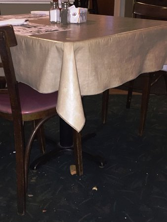East Aurora, NY: Table next to me bussed and ready for the next guest. (Note the floor.)