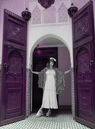 Royal Mansour Marrakech: La Carmina in her 5-star Marrakesh riad, with giant Moroccan doors and tiles.