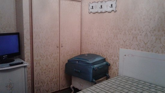 Hotel Castello: The TV has 3 channels. The cupboard below it has a fridge behind the door, but it has a hunk of