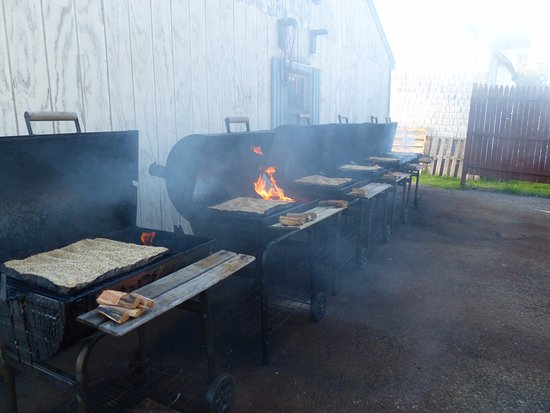 Marshfield, ME: salt being smoked on grills with different varieties of wood