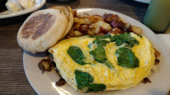 Byron Center, MI: Spinach, sausage, mushroom and cheese omelette with red skin American fries. Yum.