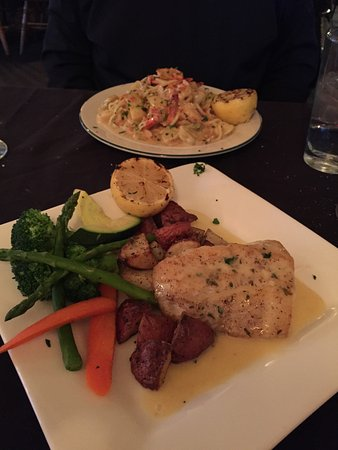Saratoga, WY: My sea bass in front - veggies were perfect too! Roger's pasta dish in back.