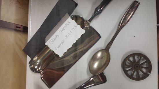 Ron Morel Memorial Museum: Silver cutlery and scraper in train exhibits
