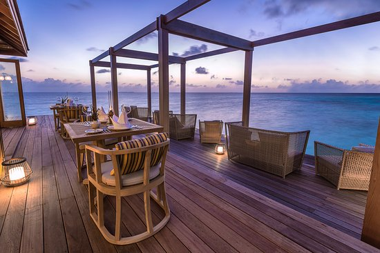 Lhaviyani Atoll: The over water Aquarium Restaurant outdoor dining