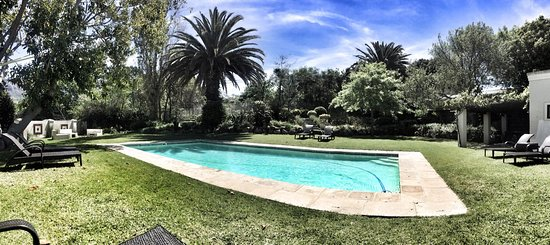 Nova Constantia Boutique Residence: Relaxing by the pool