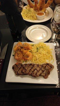 Seaside Restaurant: Hawaiian prawns with a rib eye steak and garlic pasta.