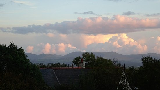 Newborough, UK: Sunset over Snowdonia from the rental