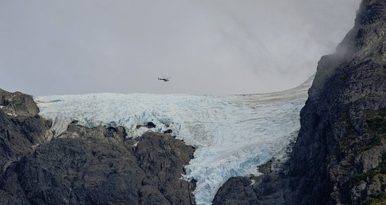 Stewart, Canada : Helicopter glacier tour, as seen from side street, Kate Ryan building entrance way.