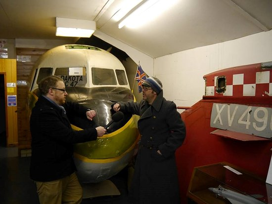 New Romney, UK: Dom King from Radio Kent interviews Vice chairman Lee Thornton infront of our Dakota cockpit