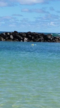 Wailua, HI: Sea wall protecting the swimming area