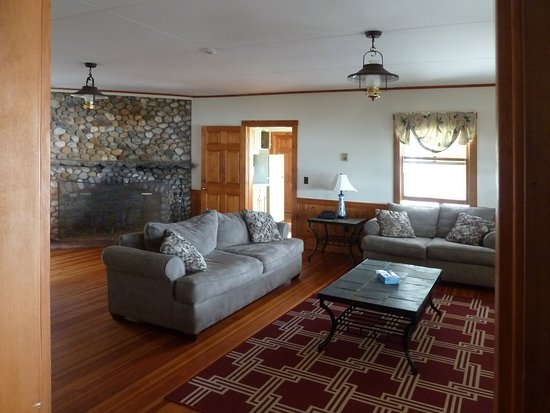Sebasco Estates, ME: Another view of the living room with the open door towards the kitchen