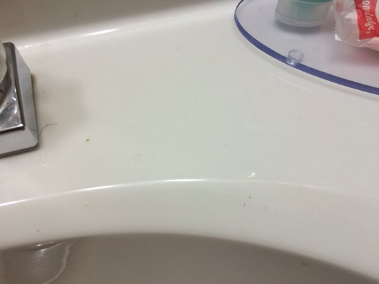 Ottawa, KS: Empty beer can box left in refrigerator; hair and makeup left on sink; hair and grime stuck to b