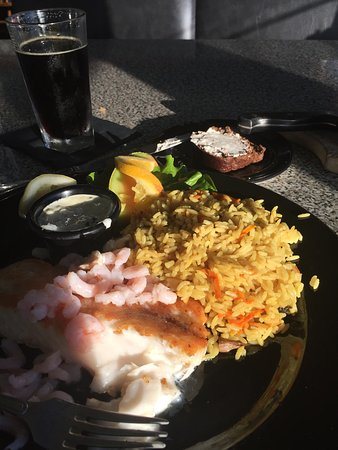 Pirate's Cove Restaurant: A sunlit dinner of fresh ling cod with rice pilaf.