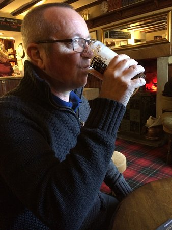 Redmire, UK: Hubby enjoying a pint
