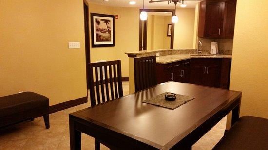 1 bedroom condo dining room and kitchen doorway to bathroom