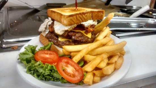 Autumn's Cafe and Grille : the Heart Attack; Full pound of 100% real beef, double bacon cheese burger with an egg, onion ri