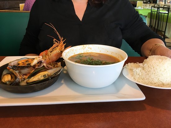 West Allis, Висконсин: Absolutely amazing Peruvian seafood soup!  Every plate that went past looked equally as creative
