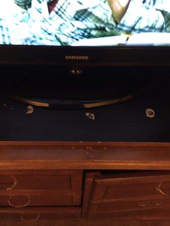 Pleasantville, NJ: Holes in TV credenza.