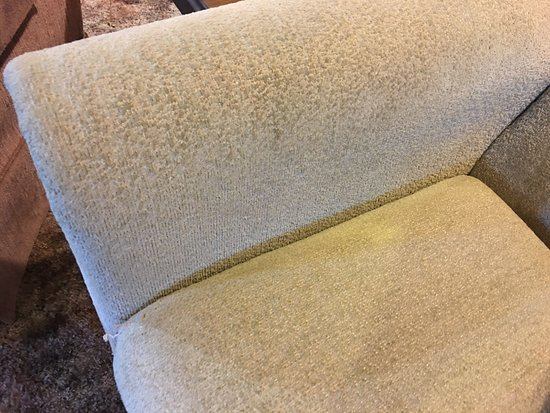 Craig, CO: Couch in living room with dirty, dingy upholstery