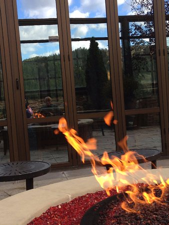 Ameristar Casino Resort Spa Black Hawk: Reflective view of firepit outside rooftop deck next to pool area