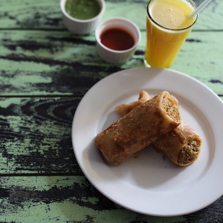 Yummy eggrolls with Raju Style Orange Juice (with Rock Salt)