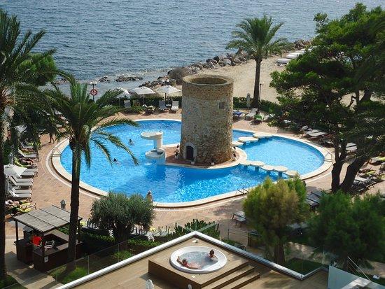 Piscina coperta foto van hotel torre del mar playa d 39 en for Piscina torre del mar