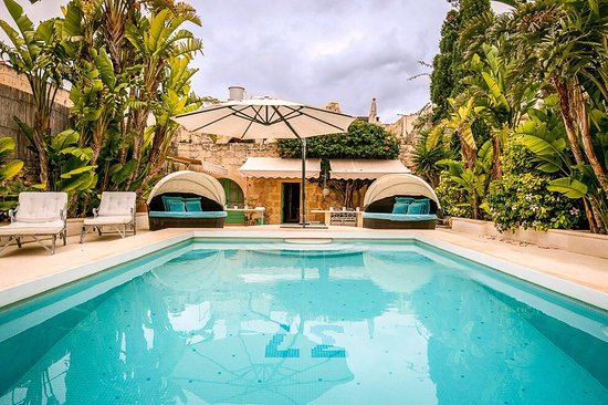 One of the two pools and relaxation areas at Thirtyseven Gozo